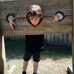 Evan in the stocks at the Rennaisance Festival. Evan was 6 years old Celia was 2 years and 10 months old Larkspur, CO
